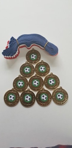 FOOTBALL MEDALS SET OF 10 WITH RED/WHITE/BLUE RIBBON