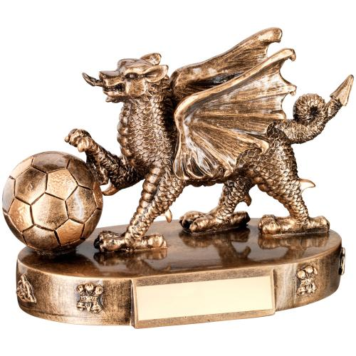 BRZ/GOLD WELSH DRAGON WITH FOOTBALL TROPHY - 4.25in